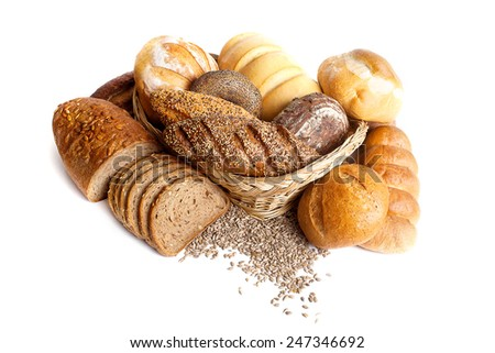 Assortment of different types of bread in a basket isolated on a white background - stock photo
