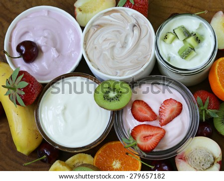 assortment of different yogurt for breakfast with berries and fruits - stock photo