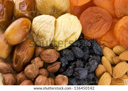 Assortment of dried fruits and nuts - stock photo