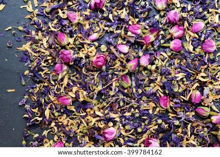 Assortment of dry herbs tea over slate background (Tea) - stock photo