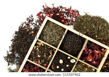assortment of dry tea in wooden box, isolated on white