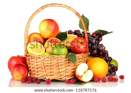 Assortment of exotic fruits in basket, isolated on white - stock photo