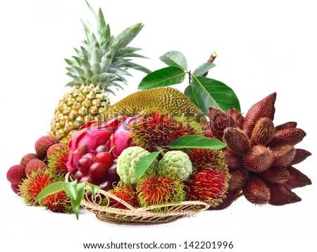 Assortment of exotic fruits isolated on white background - stock photo