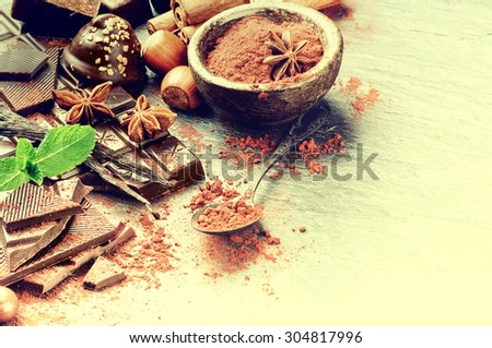 Assortment of fine chocolates and cacao powder - stock photo