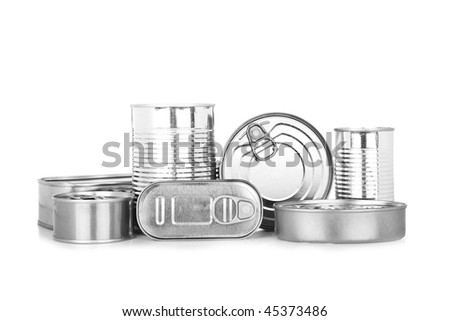 Assortment of food tin can reflected on white background - stock photo