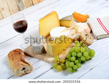 assortment of french cheeses and seasonal fruits