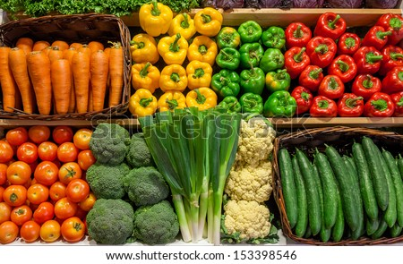 Assortment of fresh Vegetable on Shelves - stock photo