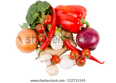 Assortment of fresh whole mixed fresh farm vegetables for used as ingredients in cooking isolated on a white background
