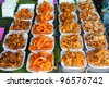assortment of fried seafood on the table (squid, shrimp, fish and crab) - stock photo