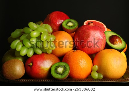Assortment of fruits on table, close-up - stock photo
