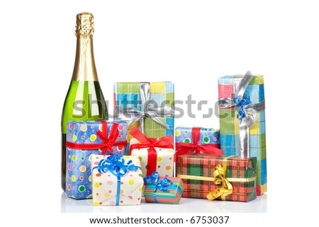 Assortment of gifts and champagne bottle, reflected on white background - stock photo