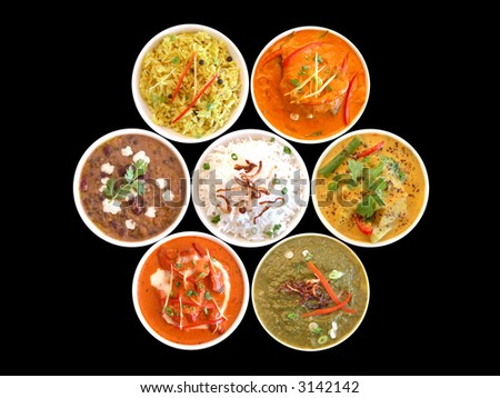 assortment of indian dishes on a black background - stock photo