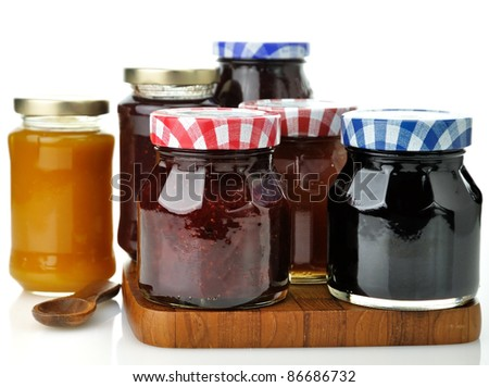 assortment of jam in the glass jars - stock photo