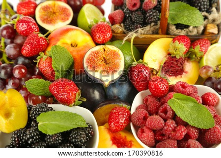 Assortment of juicy fruits and berries background