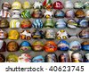 Assortment of large rings at an outdoor market - stock photo