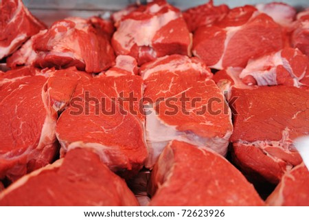 Assortment of meat at a butcher shop - stock photo