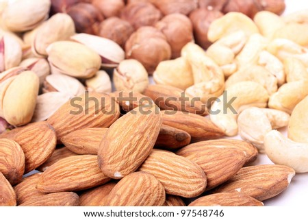 Assortment of nuts, closeup shot - stock photo
