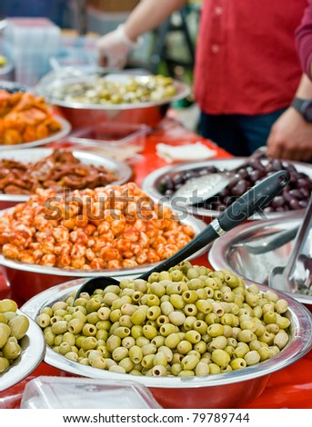Assortment of olives at farmers market - stock photo