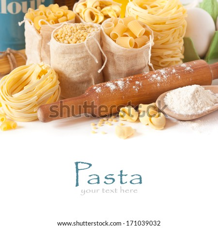 Assortment of pasta and wooden rolling pin close-up. - stock photo