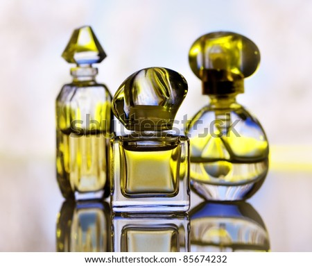 assortment of perfume bottles , close up - stock photo