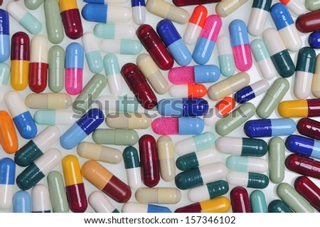 assortment of pills and capsules of colors
