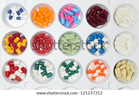 assortment of pills and capsules of colours - stock photo