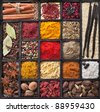 Assortment of powder spices on spoons in wooden box background - stock photo