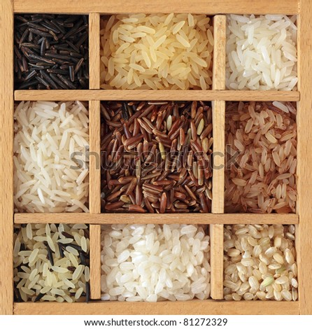Assortment of rice in wooden box - stock photo