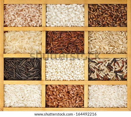 Assortment of rice in wooden box surface top view