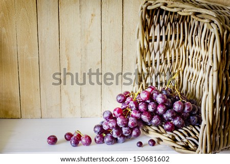 assortment of ripe sweet grapes in basket on wooden background/Grapes in the basket/ Summer Wine Season - stock photo