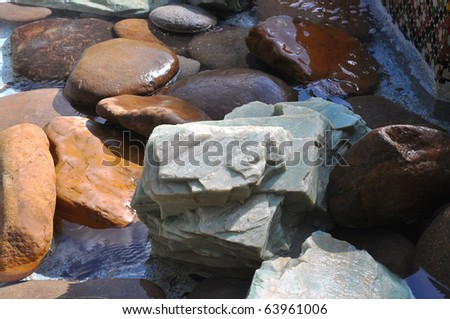 Assortment of rocks in a water fountain at a theme park