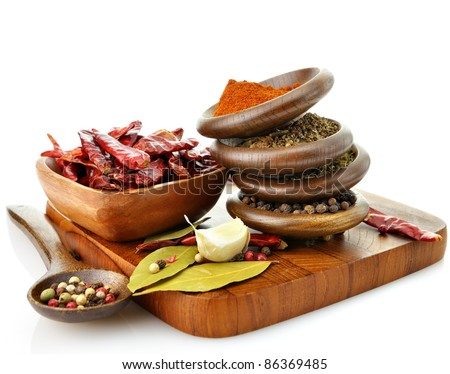 assortment of spices on a cutting board - stock photo