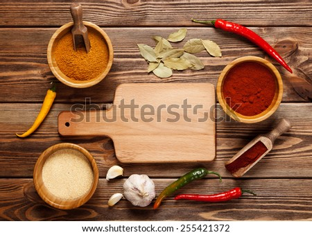 Assortment of spices on a wooden table. - stock photo