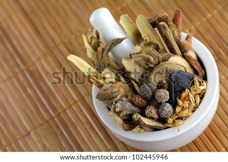 Assortment of Traditional Chinese herbal tea (Medicinal herbal tea) in a mortar - stock photo