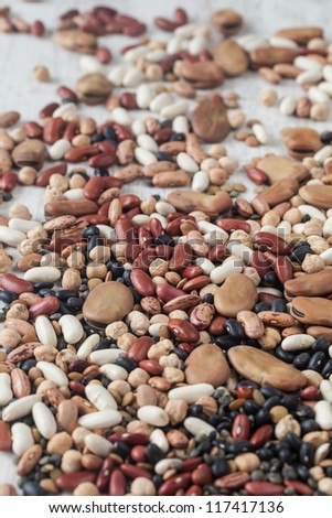 Assortment of various raw mixed legumes on the table