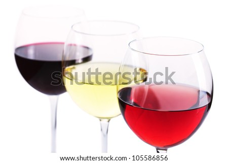 Assortment of wine - red, white and rose wine over white background