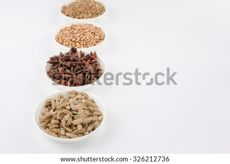 Assortment spice,star anise,cardamom,cumin seed and coriander seed in white bowl over white background  - stock photo