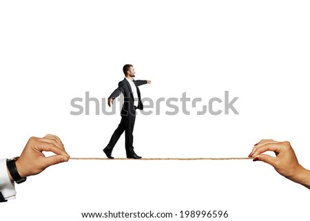 Assured businessman tight rope walking against a white background. - stock photo