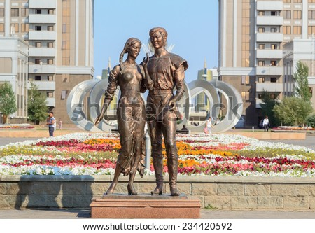 Astana, Kazakhstan - August 18, 2014: The photo shows sculpture two young, woman and man, symbolizing love. is located in ,