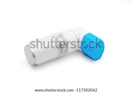 asthma inhaler on white background - stock photo