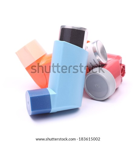 Asthma inhalers isolated over white - stock photo