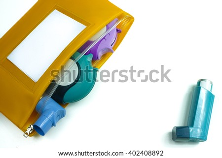 Asthma relief concept, salbutamol inhaler, another medication and yellow medical plastic bag, copy space