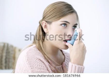 Asthma Treatment, Woman - stock photo