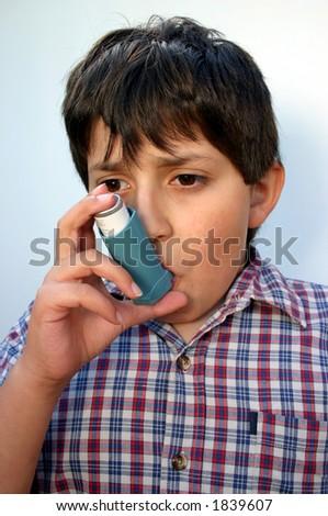 Asthmatic boy - stock photo