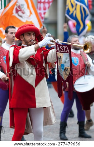 Asti, Italy - September 19, 2010: the historic Medieval parade of the Palio of Asti in Piedmont, Italy. Reenactment in medieval costumes, Trumpeter
