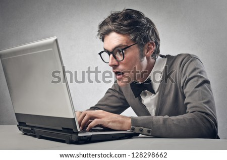 astonished boy working on laptop - stock photo