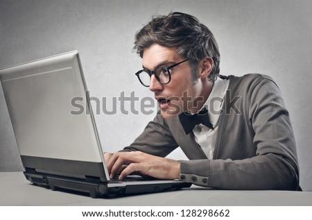 astonished boy working on laptop - stock photo