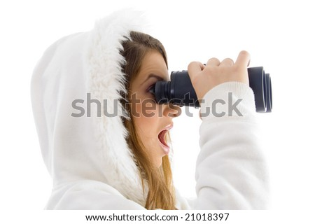 astonished female watching through binocular on an isolated background - stock photo