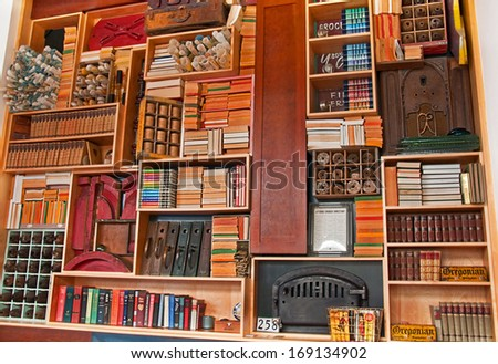 ASTORIA, OR/USA - JULY 21, 2011: Magnificent vintage bookcase is displayed in a popular tourist attraction display.  Educational and informative to previous eras. - stock photo