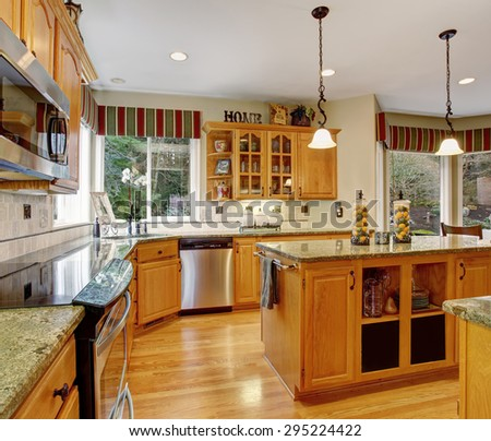 Astounding kitchen with marble island and perfect decor. - stock photo